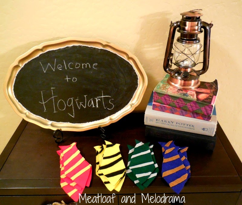 chalkboard welcome to hogwarts sign with harry potter books, lantern and  felt ties