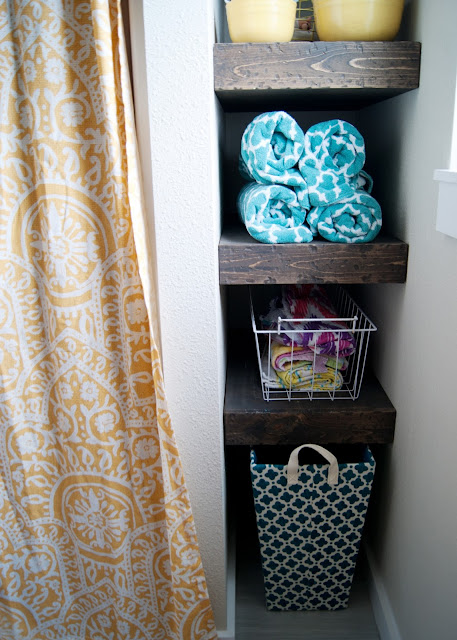 Bathroom Makeover - before & after - Chunky wood shelves in nook