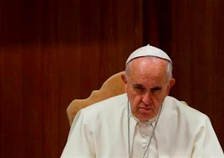 Pope scowling