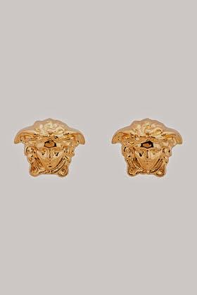 http://www.ssense.com/women/product/versace/gold_medusa_stud_earrings/101506