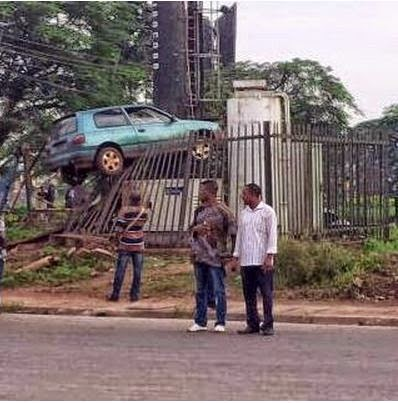 Car parked ontop of a fence in Benin, Edo State