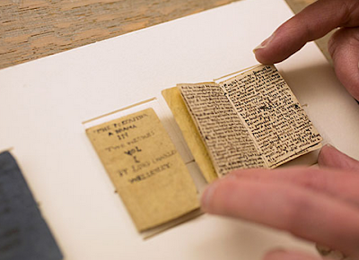http://www.openculture.com/2014/07/13-year-old-charlotte-bronte-her-brother-wrote-teeny-tiny-adventure-books-measuring-1-x-2-inches.html