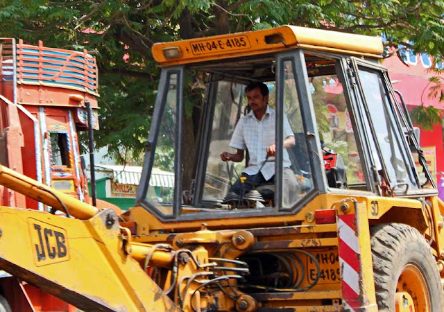 driver of an earth mover or crane