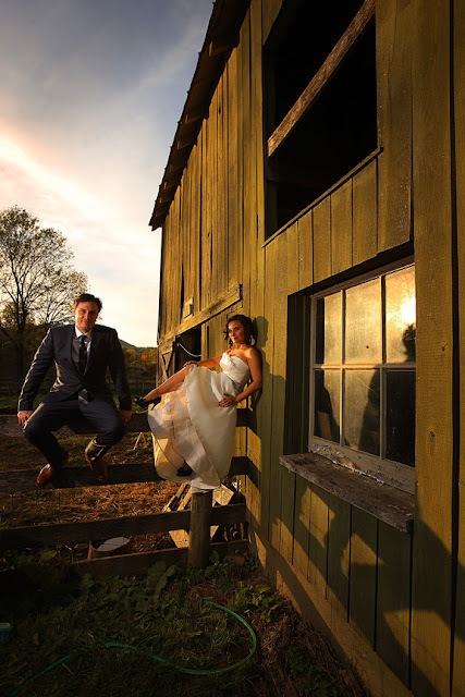 Bride and Groom Sitting on farm Fence Mount Vernon farm| Whysall Photography