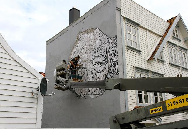 street artist vhils at work for nuart 2013