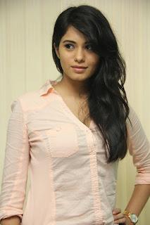 Deepa Sannidhi in Jeans and Light Cream Shirt at Yatchan Team Interview