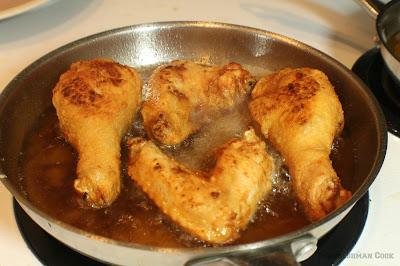 wings, legs cooking in oil
