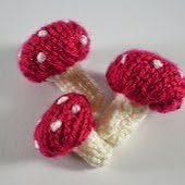 http://www.ravelry.com/patterns/library/woodland-wreath-toadstools