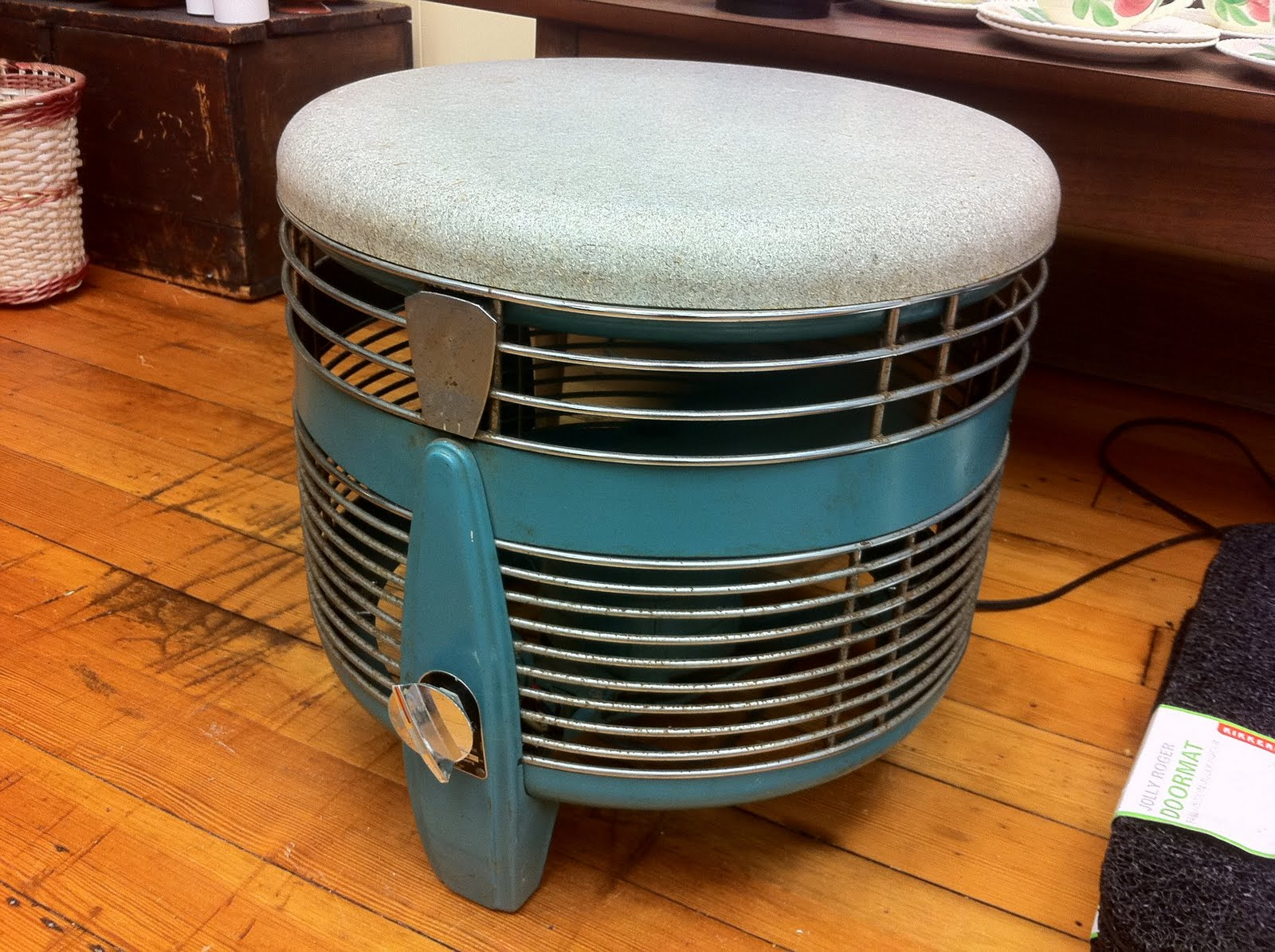 This is the coolest vintage floor fan that you ever did see 360 degrees of air and you can sit on it sold