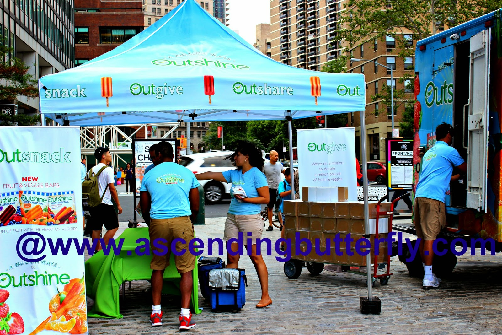 Outshine Snacks distributing frozen Fruit & Veggie Snack Bar Samples near Pearl Street New York City South Street Seaport