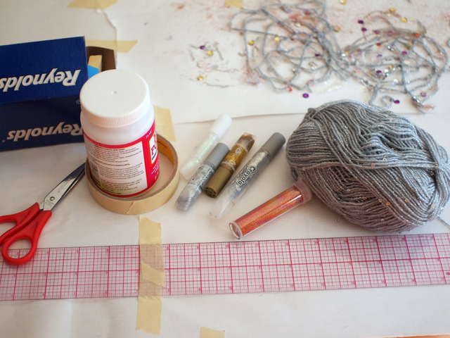 materials needed to make sparkly and lacy yarn spider webs
