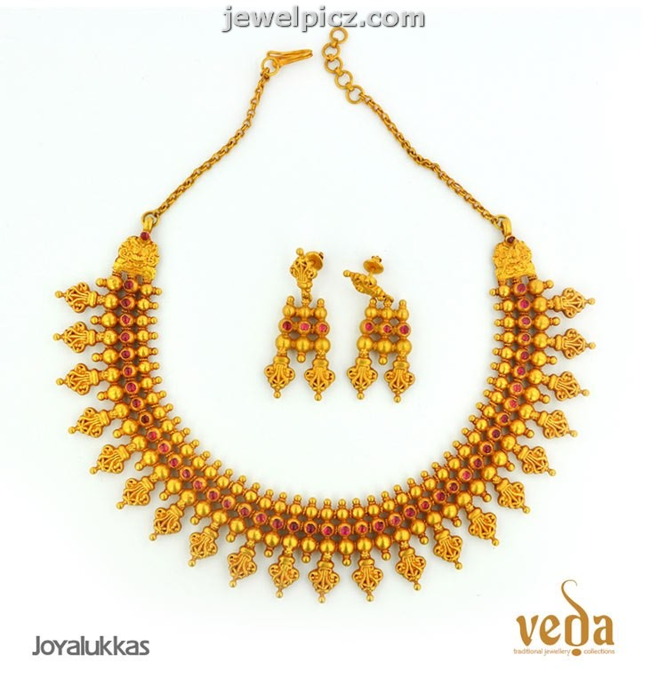 alukkas gold temple necklace designs veda collection