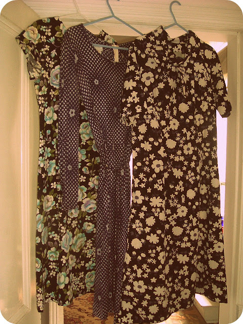 Some floral frockery the turquoise and black cotton shift on the left