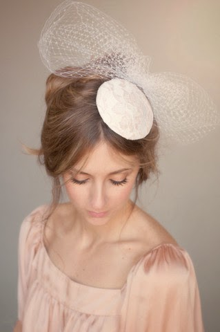 http://www.whitetrufflestudio.com/collections/headpieces-1/products/bridal-lace-and-birdcage-bow-headpiece-style-116