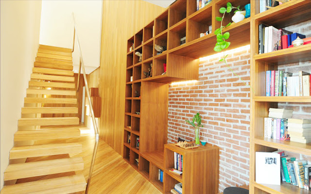 Photo of wooden staircase and the hallway in one of the apartments