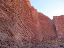 Massive pitted red rock walls at Wadi Rum, Jordan