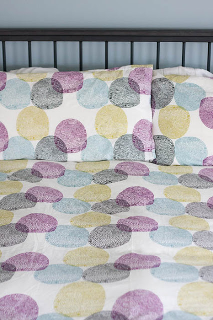 duvet cover and pillowcases with colorful dots