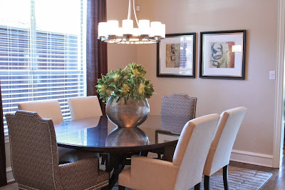 elegant and stylish dining room with eye-catchy silver table center piece