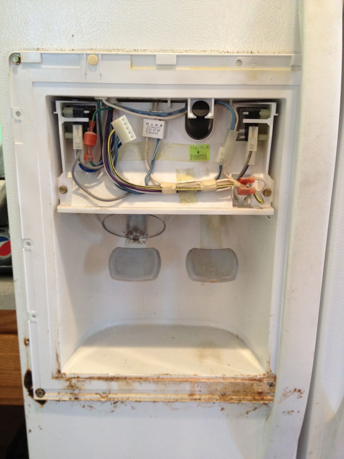 How To Repair The Seal On The Ice Dispenser Door On A