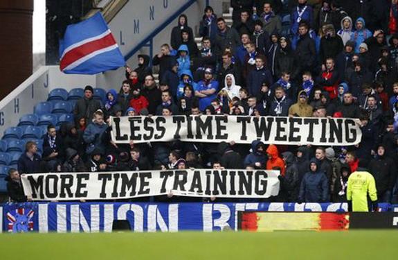 Rangers fans unfurl banner 'Less time tweeting, more time training'