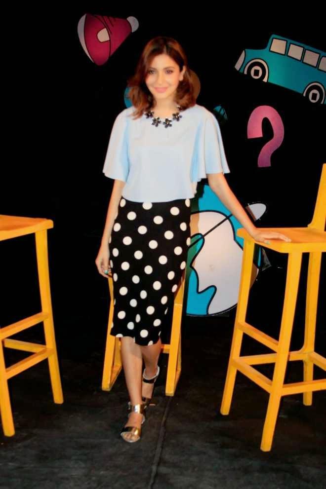 Anushka Sharma Latest Stills in Sky Blue Top and Black Mini Skirt