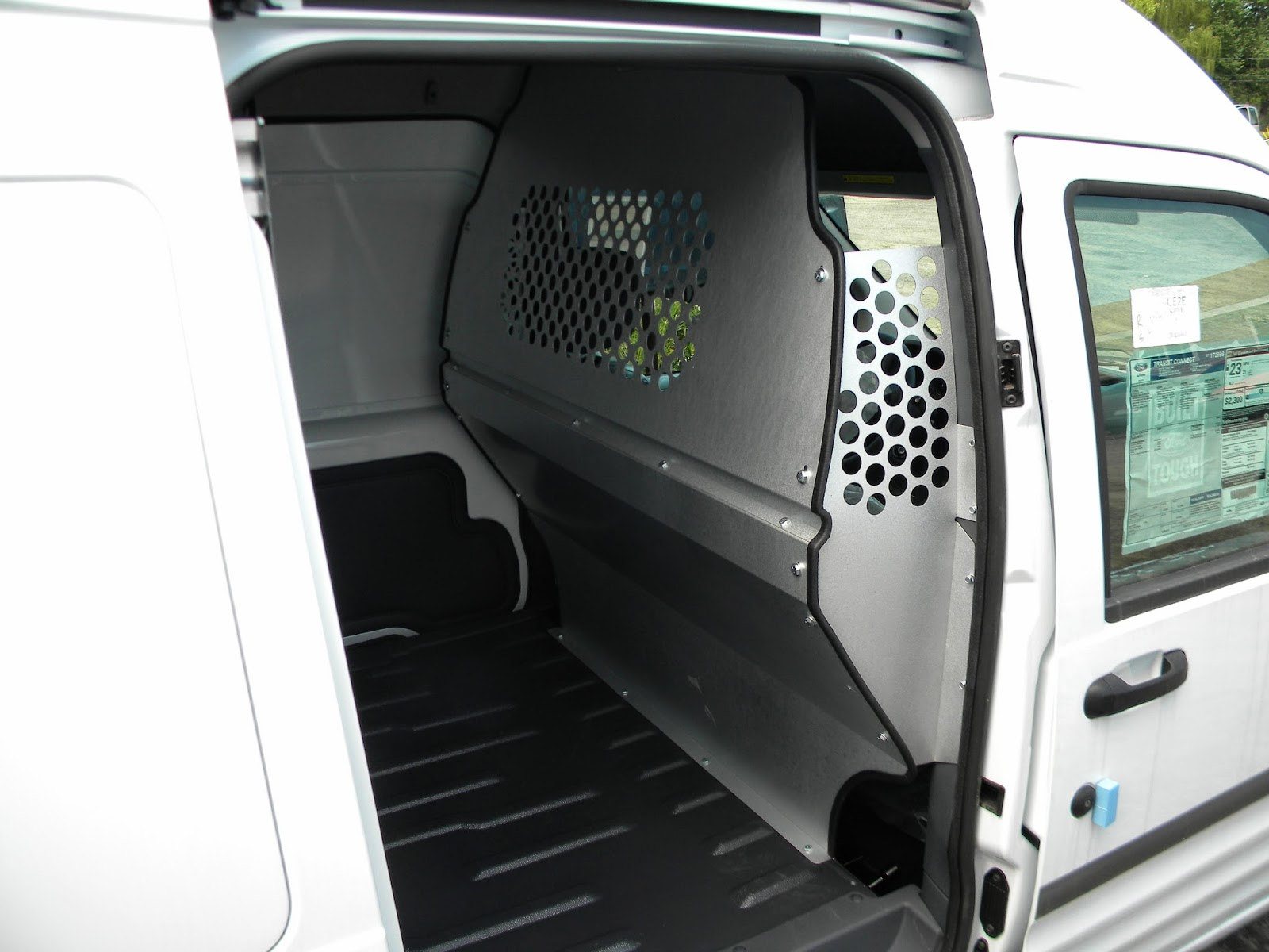 Contoured partition with perforated window for a ford transit connect c10 v