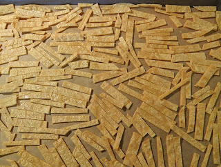 Tortilla Strips spread out on Baking Sheet