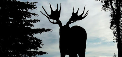 silhouette of bull moose statue in Dryden Ontario against morning sky