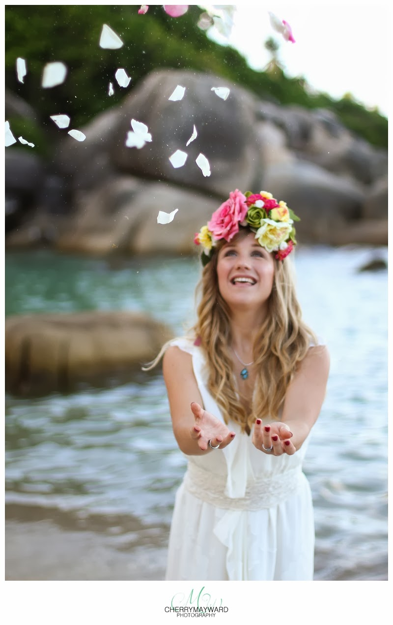 throwing petals in the air, beautiful bride throwing petals, Thailand wedding photographer,