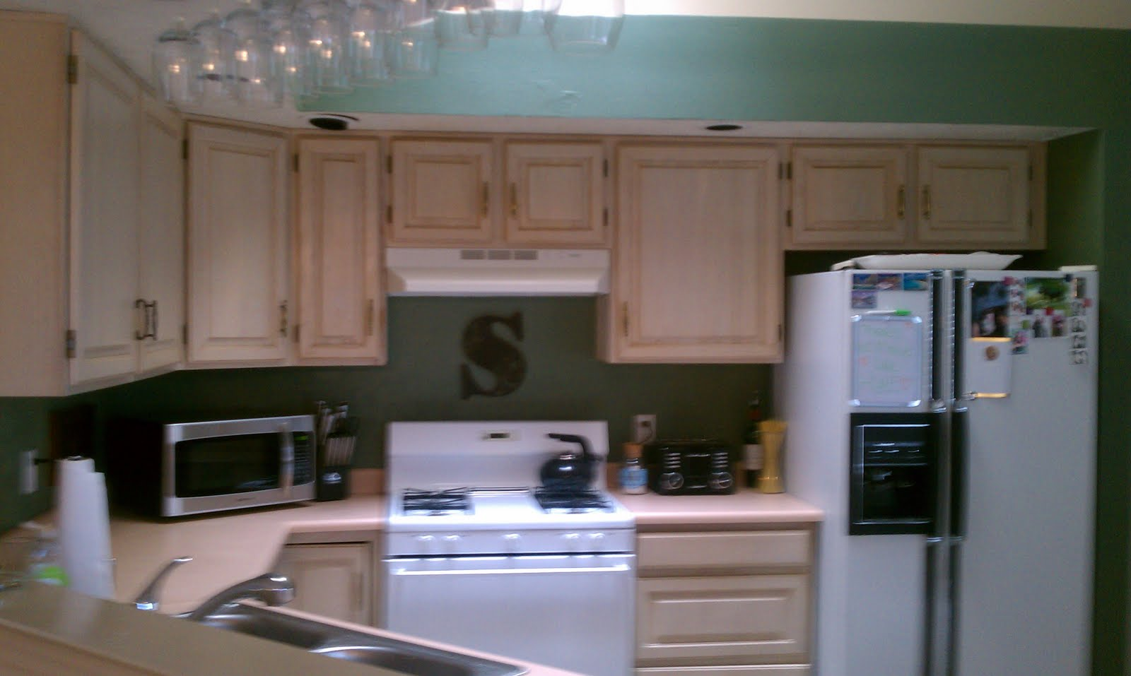 Love can make any house a home staining the kitchen for Can you stain kitchen cabinets