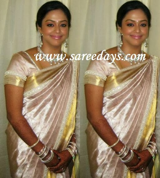 Latest saree designs jyothika in silver pattu designer saree checkout jyothika in silver pattu designer saree with self work and white pearl small border and gold zari border and paired with matching short sleeves altavistaventures Image collections