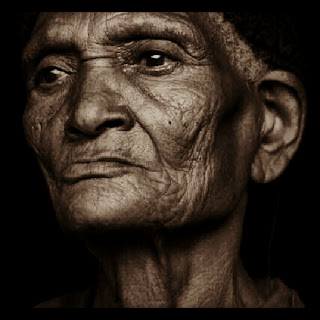Photograph of old woman in Ethiopia by Ethiopian photographer Michael Tsegaye