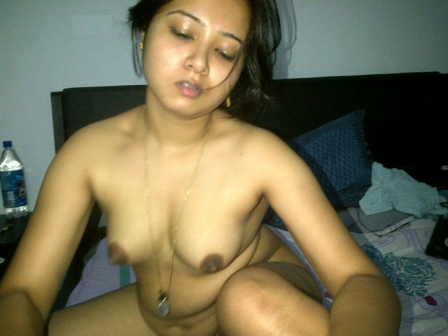 Young girlfriend squeezing her tits