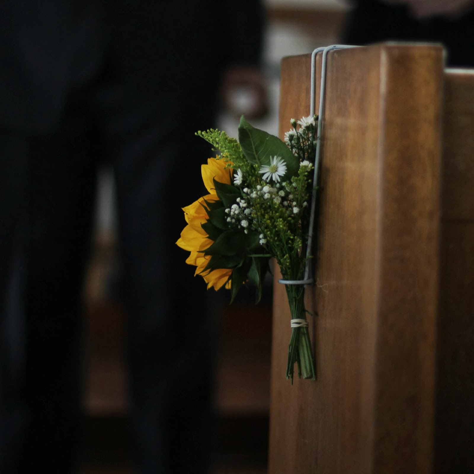 attaching flowers to pews/seats