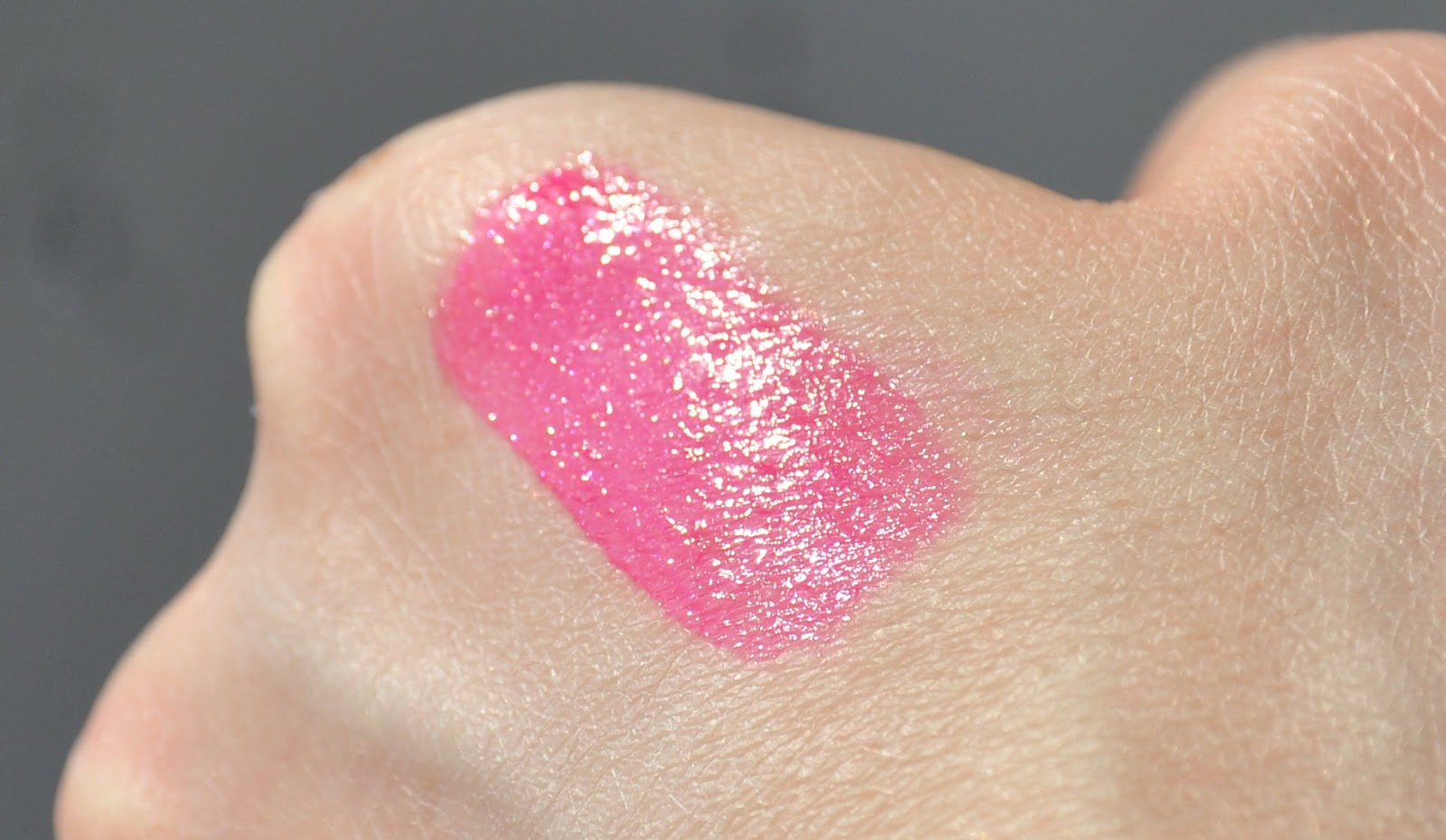 YSL Gloss Volupte Extreme Shine #49 Terriblement Fuchsia
