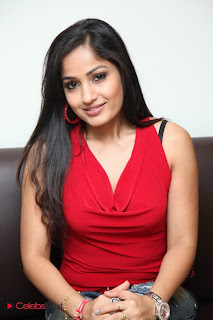Madhavi Latha  Pictures in Red Sleeveless Top and Jeans at Muse Art Gallery  0005.jpg