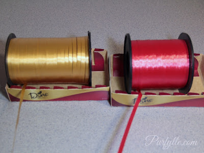 Keep curling ribbon from getting tangled by laying them in a box.