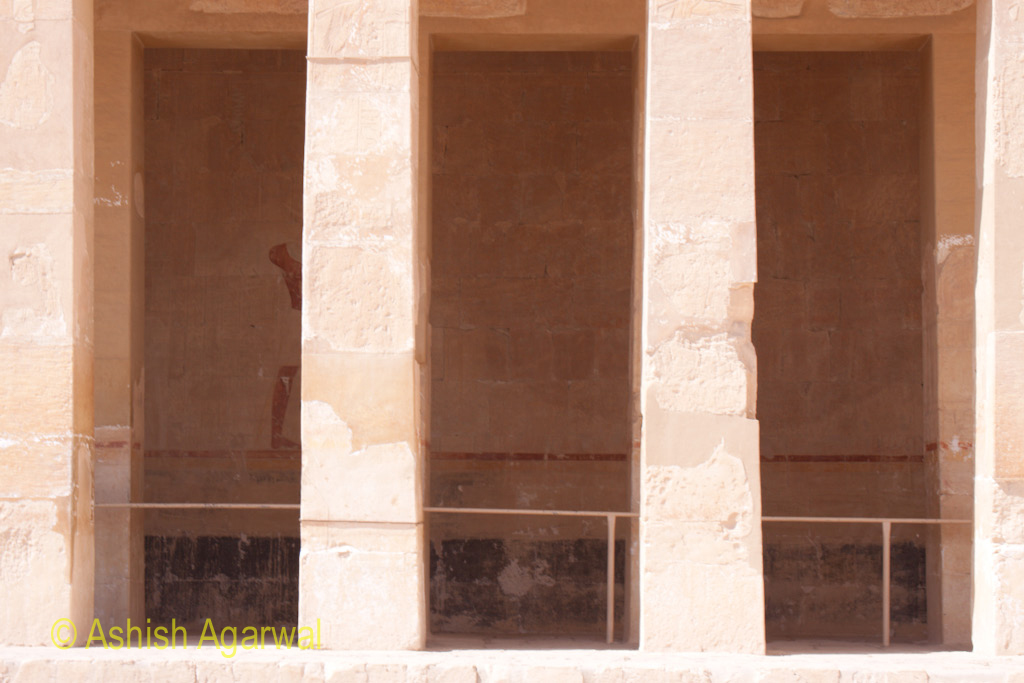 Closer view of a section of the mortuary temple of Queen Hatshepsut in Deir El Bahri, near Luxor in Egypt shows massive windows in the wall
