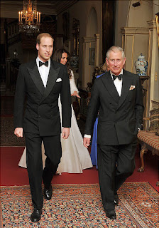 Like father like son Prince William and his dad, Prince Charles stroll to the wedding reception decked out in classic tuxedos