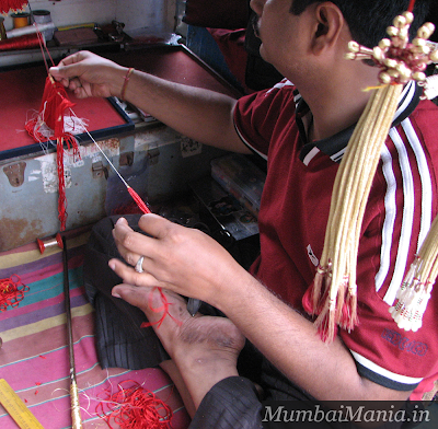 making tassles at jewelry market dagina-bazaar