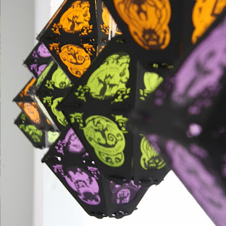Halloween Lanterns with Cornish Litany imagery hang to create tessellations of orange, purple, and green at the art studios of Bindlegrim