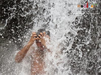 Bathing under Bhagsu Falls