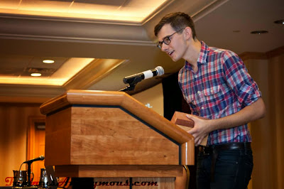 a picture of sam alden taken at the ignatz awards where he won best mini comic
