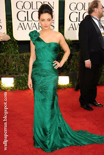 Actress Mila Kunis arrives at the 68th Annual Golden Globe Awards in Beverly Hills, California