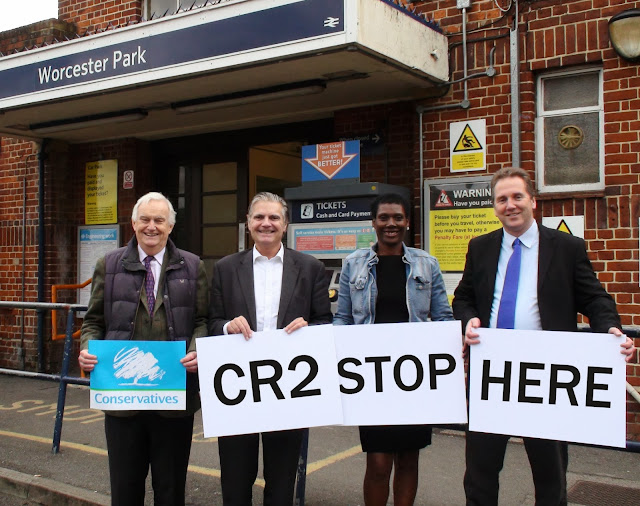 Councillor Stuart Gordon Bullock, Steve O'Connell AM, Gloriana Andrew and Simon Densley holding up signs spelling out 'CR2 Stop Here' and a 'Conservatives' poster