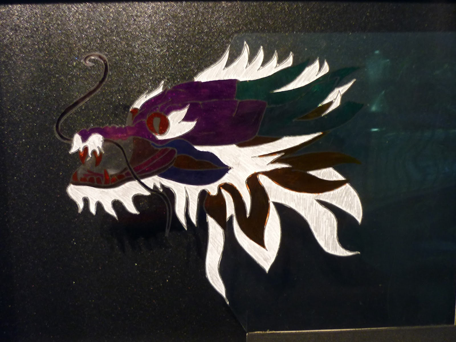 how to make a dragon shadow puppet