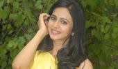 splendid hot sexy Rakul preet singh latest beautiful photos in yellow