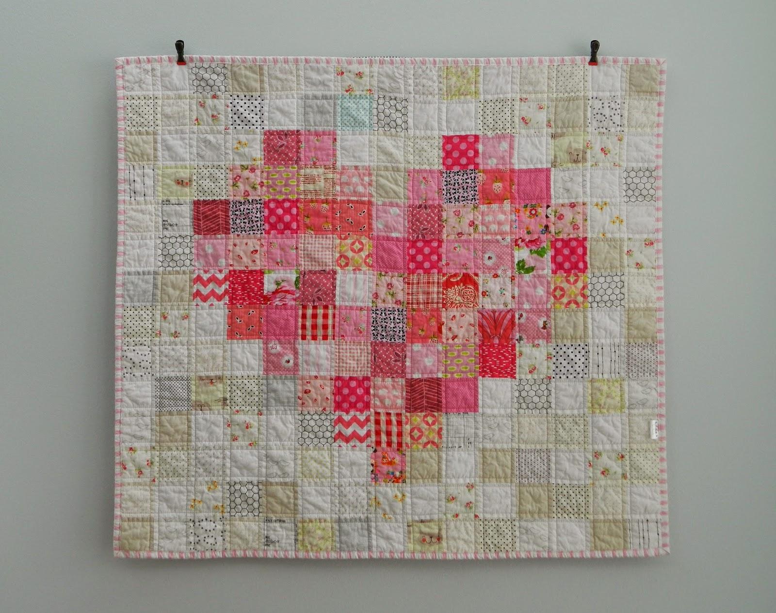 http://sotakhandmade.blogspot.com/2014/05/pink-love-finished-baby-quilt.html