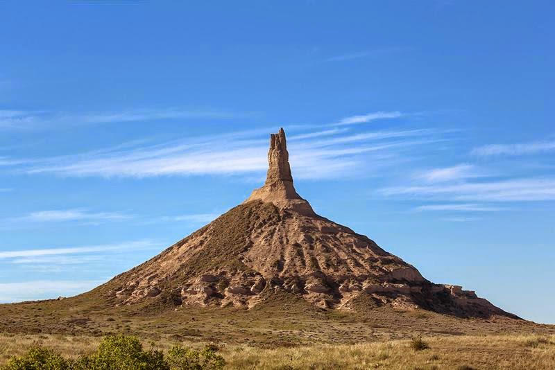 Chimney Rock, located in Morrill County in western Nebraska, California. A prominent geological rock formation Rising nearly 300 feet above the surrounding North Platte River valley, the peak of Chimney Rock is 4,226 feet above sea level