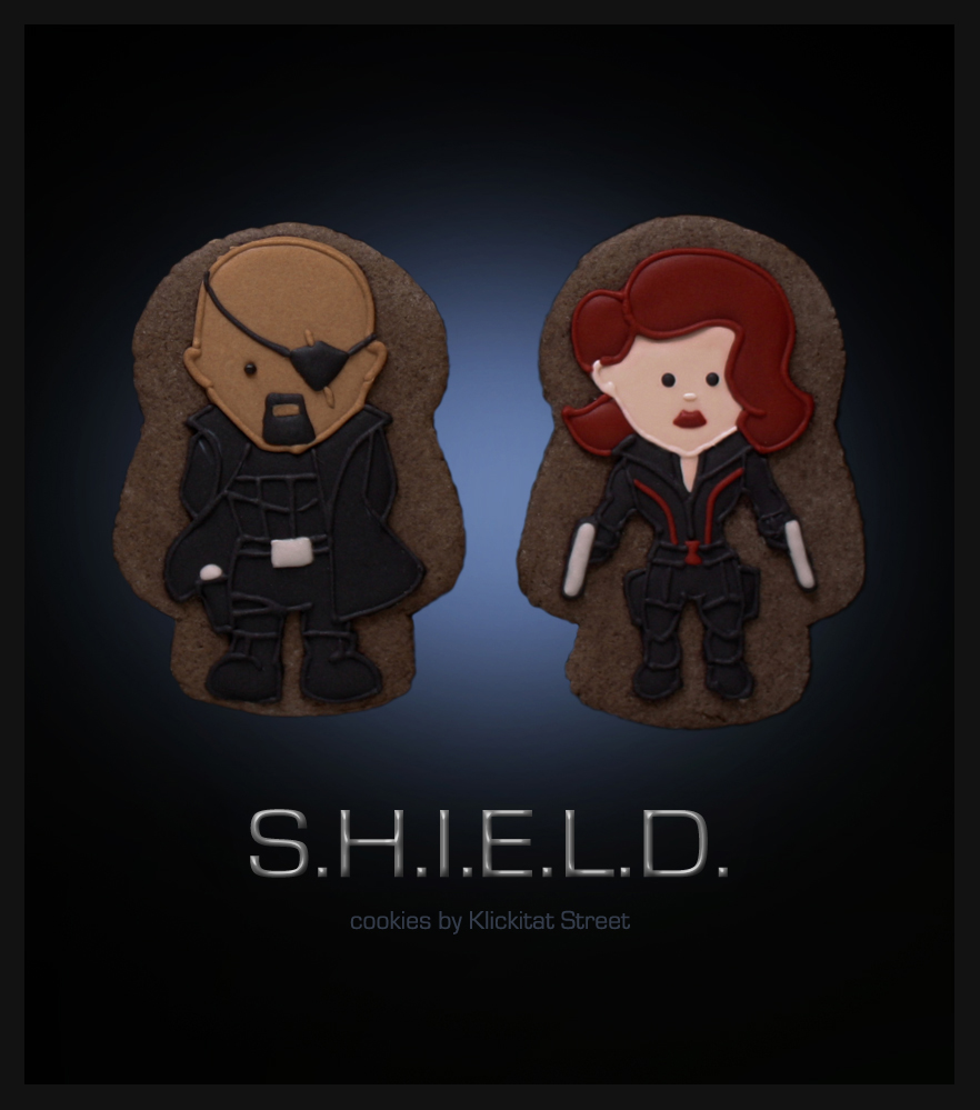 decorated sugar cookie of Marvel Avengers movie characters Nick Fury and Black Widow